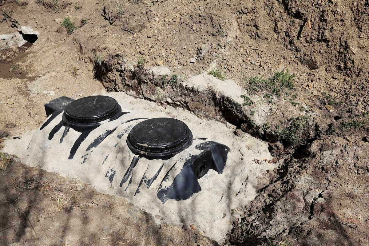 Overhead diagonal view of a newly installed septic tank system at a residential property - Swimming Pools Near Septic Tanks