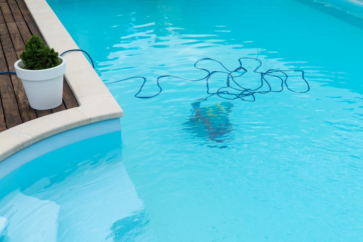 Robot cleaning a swimming pool - Robot Pool Cleaner Buying Guide