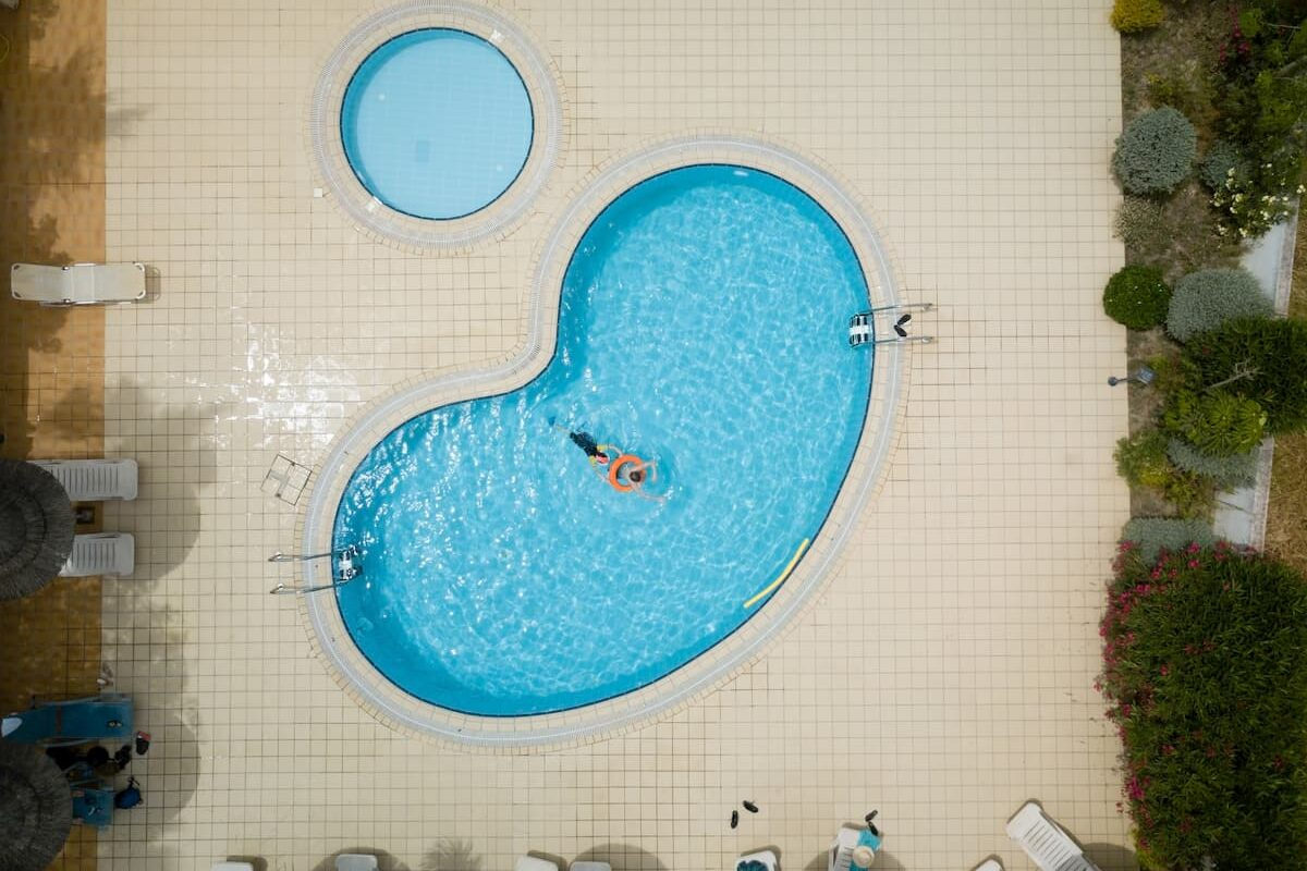 Cool Drone image of a kidney shaped pool from above