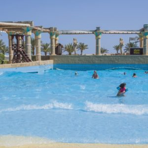 The children thrive with swimming in a wave pool at Cleo water park located at the hotel Hilton Sharm Dreams Naama Bay, Egypt